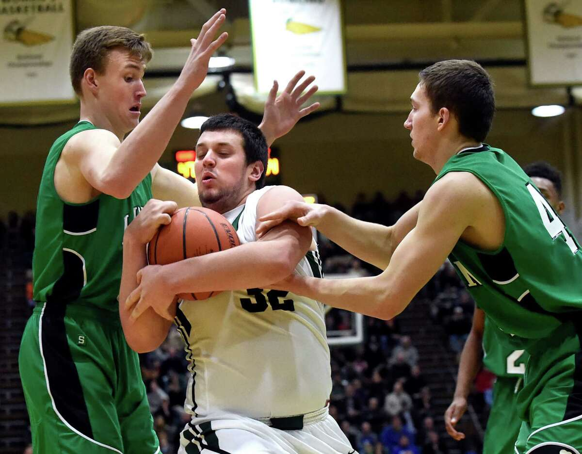 Shen's Michael Gillooley, center, protects the ball as Bishop Ludden's Chris Allen, left, and Jim Grabowski defend during their Class AA basketball regional final on Saturday, March 5, 2016, at Hudson Valley Community College in Troy, N.Y. (Cindy Schultz / Times Union)