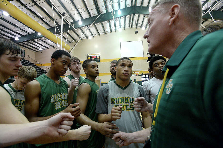 East Chambers' varsity rally together with coach Todd Sutherland at the end of practice Tuesday morning in preparation for Thursday's state semi-final game in San Antonio. Photo taken Tuesday, March 8, 2016 Kim Brent/The Enterprise Photo: Kim Brent Kim Brent / Beaumont Enterprise