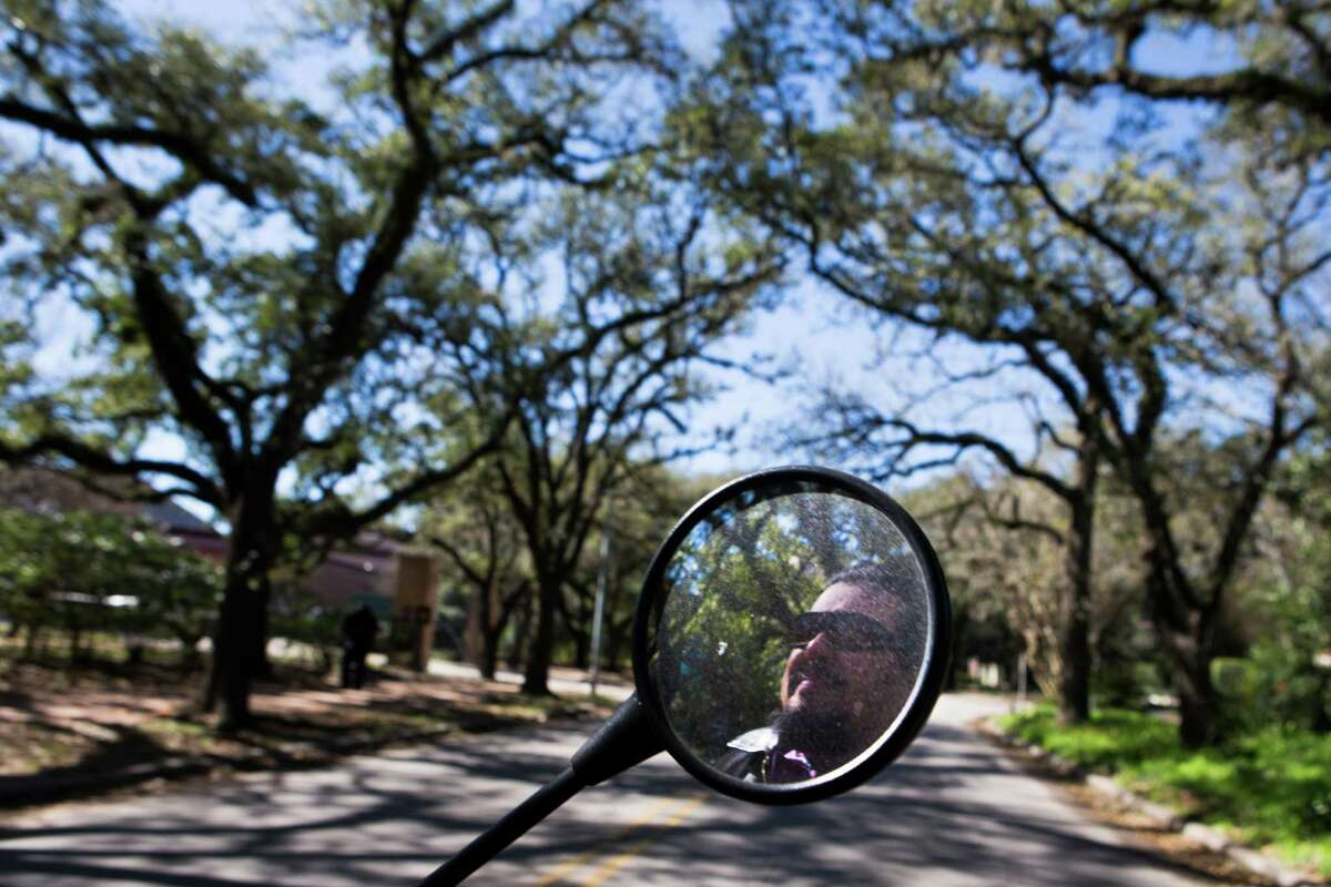 Arturo Perez drives his classic Ural sidecar motorcycle near Rice University in Houston as part of the Houston Sidecar Tours. Wednesday, Feb. 24, 2016, in Houston. ( Marie D. De Jesus / Houston Chronicle )