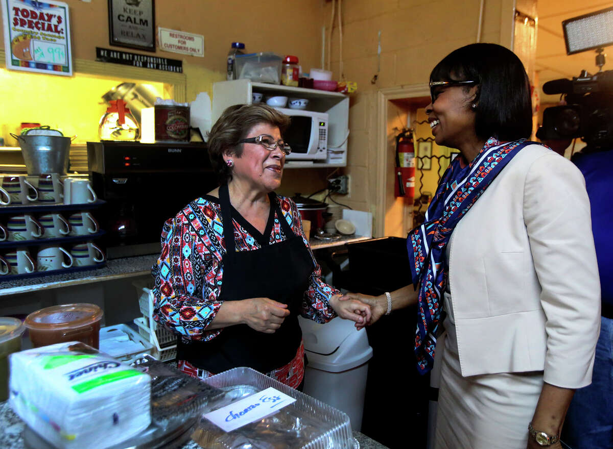 San Antonio Mayor Ivy Taylor (right) greets Mittman Fine Foods owner Mary Benavides (left) Thursday while picking up tacos to take to Austin for the Breakfast Taco Summit with Austin Mayor Steve Adler.