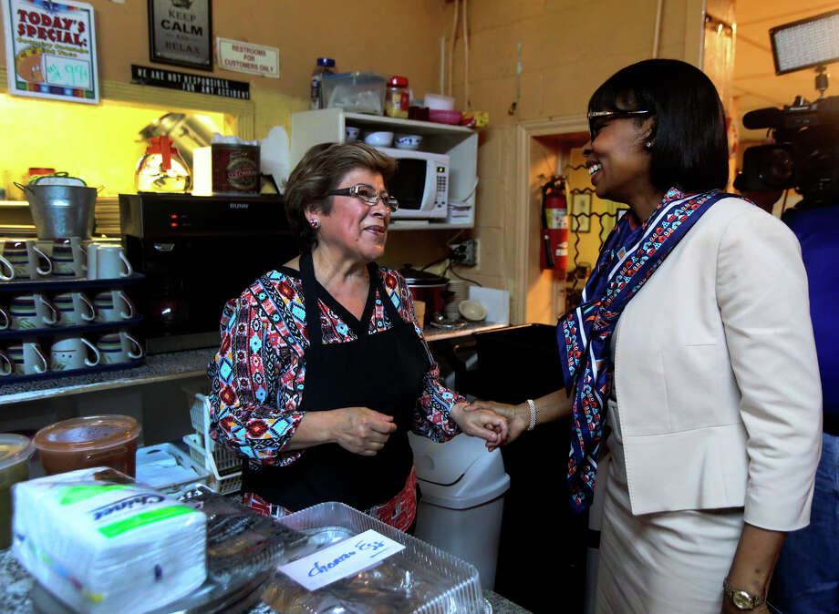 San Antonio Mayor Ivy Taylor (right) greets Mittman Fine Foods owner Mary Benavides (left) Thursday while picking up tacos to take to Austin for the Breakfast Taco Summit with Austin Mayor Steve Adler. Photo: John Davenport /San Antonio Express-News / ©San Antonio Express-News/John Davenport