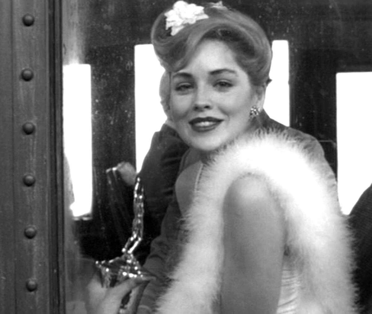 No. 1. She had a brief, nonspeaking role in a train coach scene in Woody Allen's