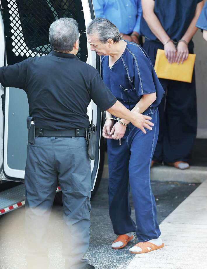 Armando Jesus Hernandez Leal is led out of John H. Wood Federal Courthouse on Wednesday, Aug. 26, 2015 after a plea hearing for which he is accused of stealing $66 million from investors. The Mexican banker plead guilty to money laundering after admitting to forging documents to steal money from Mexican investors. (Kin Man Hui/San Antonio Express-News) Photo: Kin Man Hui, Staff / San Antonio Express-News / ©2015 San Antonio Express-News