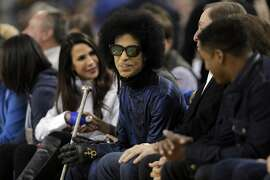 Prince sits courtside in the first half as the Golden State Warriors played the Oklahoma City Thunder at Oracle Arena in Oakland, Calif., on Thursday, March 3, 2016.