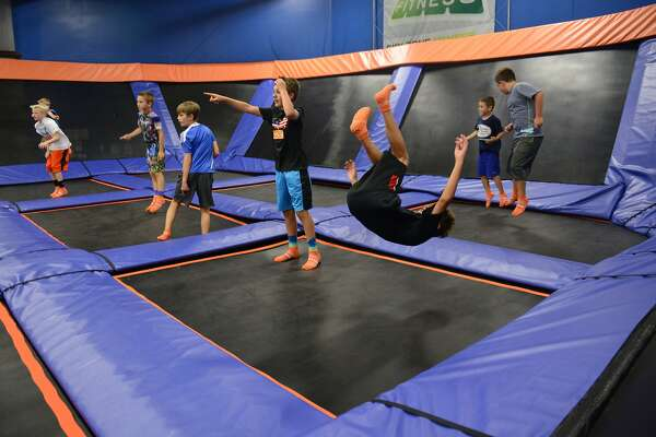 Kids jump while playing a game of dodgeball at Sky Zone indoor trampoline park in Bethel, Conn. Wednesday, Aug. 13, 2014.  There have been a number of trampoline parks making their way into southwestern Connecticut recently.