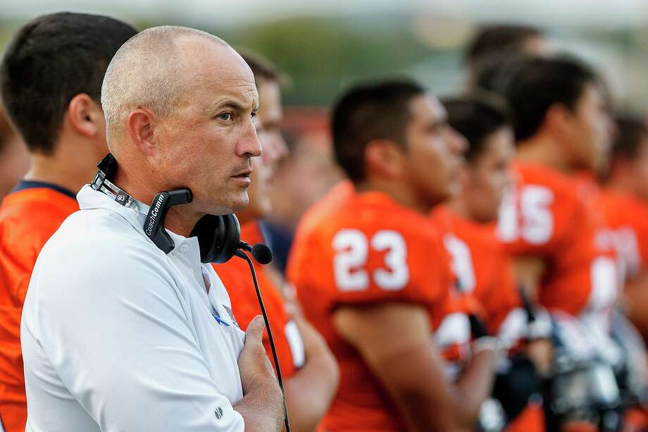 Brandeis coach John Campbell on the sidelines as the national anthem is sung prior to the Broncos' season opener with Smithson Valley at Farris Stadium on Aug. 31, 2012. Photo: Marvin Pfeiffer /San Antonio Express-News / Express-News 2012