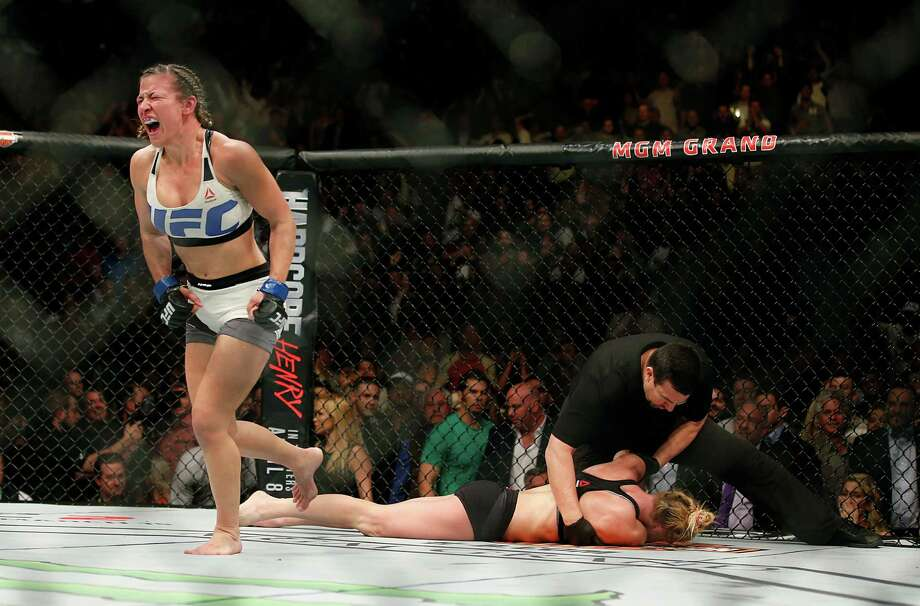 Miesha Tate celebrates her victory over Holly Holm just after their UFC 196 womens bantamweight mixed martial arts title match on March 5, 2016, in Las Vegas. Tate won by fifth round submission. Photo: Eric Jamison /Associated Press / FR156391 AP