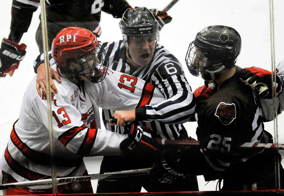 Officials separate Rensselaer Polytechnic Institute's Jared Wilson (13) Brown's Brandon Pfeil (25) during the first period of Game 1 of a Eastern College Athletic Conference hockey playoff series in Troy, N.Y., Friday, March 4, 2016. (Hans Pennink / Special to the Times Union) ORG XMIT: HP101