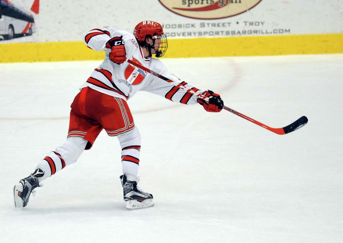 Rensselaer Polytechnic Institute's Jared Wilson's (13) scores a goal against Brown to win the game during the third period of Game 2 of a Eastern College Athletic Conference hockey playoff series in Troy, N.Y., Saturday, March 5, 2016. RPI won the game and series with a 4-3 win against Brown. (Hans Pennink / Special to the Times Union) ORG XMIT: HP111