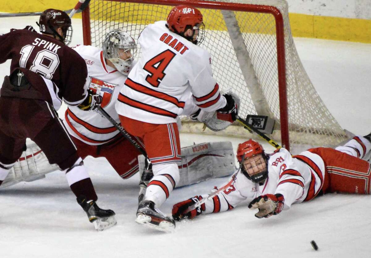 Colgate's #18 Tylor Spink, left, can't get past RPI defenders, from left, goalie Jason Kasdorf, #4 Tommy Grant and #13 Jared Wilson during Saturday's game at the Houston Field House Jan. 16, 2016 in Troy, NY. (John Carl D'Annibale / Times Union)