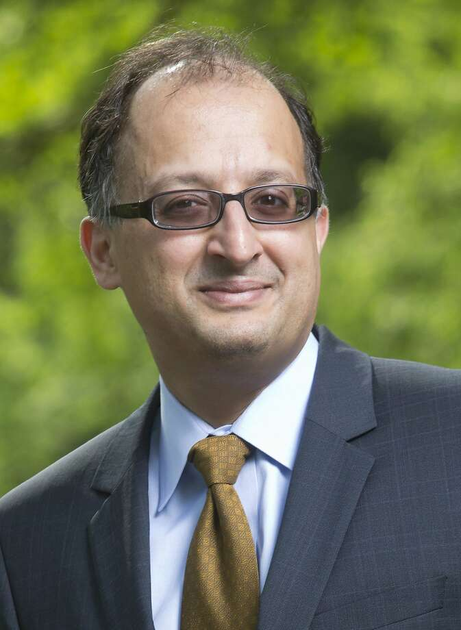 This May 12, 2014 photo released by the Univesity of California Berkeley shows Berkeley Law Dean Sujit Choudhry in Berkeley, Calif. The dean of UC Berkeley's law school went on an indefinite leave of absence from the post Wednesday, March 9, 2016, after his executive assistant sued him over allegations of sexual harassment and the university for allegedly not doing enough to prevent it. (University of California Berkeley via AP) Photo: AP