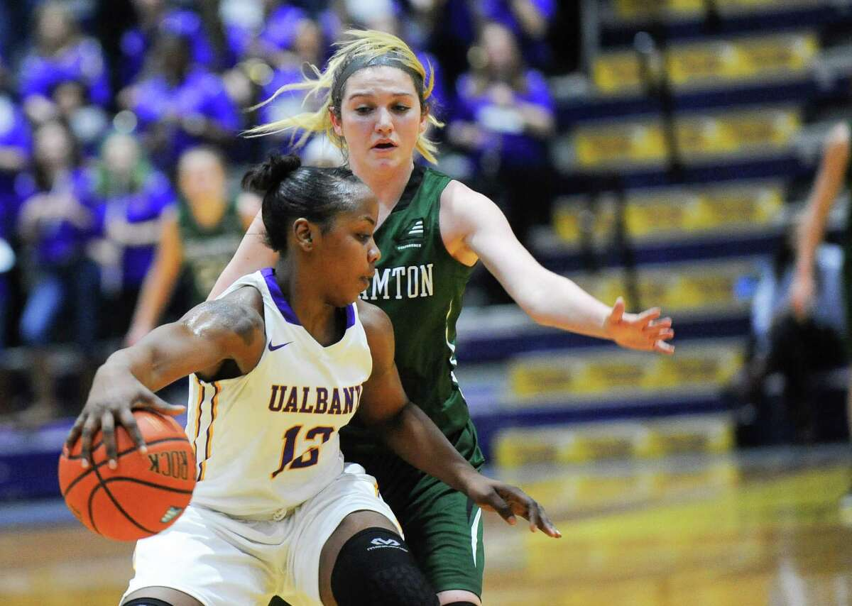 UAlbany's Imani Tate moves the ball infront of Binghamton's McKayla Hernandez during the first half of an NCAA women's college basketball game on Monday, Feb. 8, 2016, in Albany, N.Y. (Hans Pennink / Special to the Times Union) ORG XMIT: HP111
