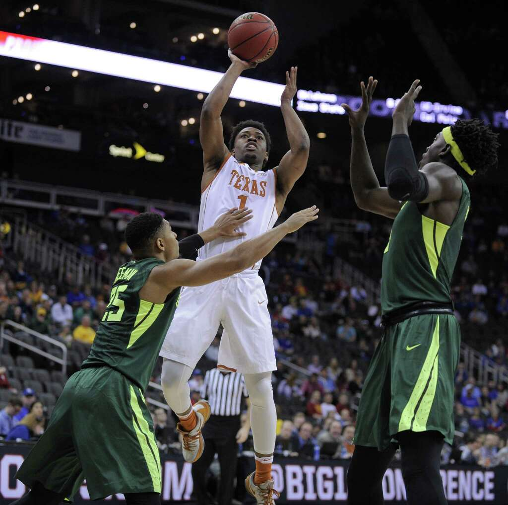 KANSAS CITY, MO - MARCH 10: Isaiah Taylor #1 of the Texas Longhorns shoots against Al Freeman #25 and Johnathan Motley #5 of the Baylor Bears in the first half during the quarterfinals of the Big 12 Basketball Tournament at Sprint Center on March 10,										