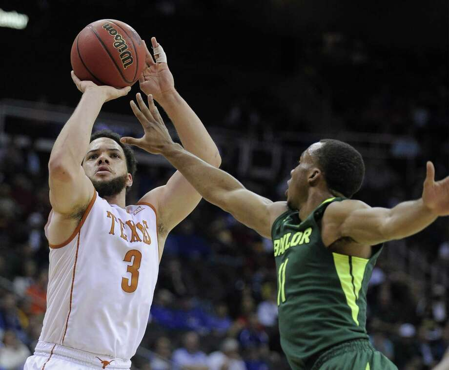 KANSAS CITY, MO - MARCH 10:  Javan Felix #3 of the Texas Longhorns shoots against Lester Medford #11 of the Baylor Bears in the first half during the quarterfinals of the Big 12 Basketball Tournament at Sprint Center on March 10, 2016 in Kansas City, Missouri. Photo: Ed Zurga, Getty Images / 2016 Getty Images
