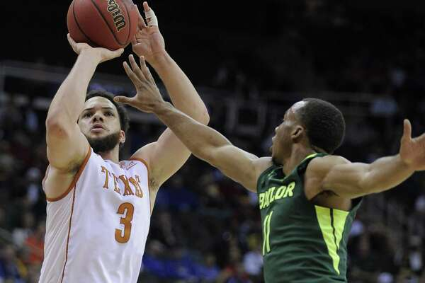 KANSAS CITY, MO - MARCH 10:  Javan Felix #3 of the Texas Longhorns shoots against Lester Medford #11 of the Baylor Bears in the first half during the quarterfinals of the Big 12 Basketball Tournament at Sprint Center on March 10, 2016 in Kansas City, Missouri.