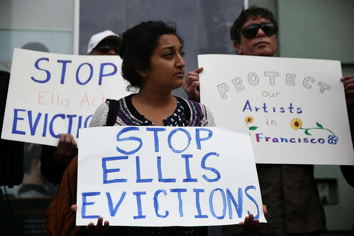 FILE: Activists and tenants of 1049 Market Street hold signs as they stage a protest against the landlord's attempts to evict them from the building on March 8, 2016 in San Francisco, California. (Photo by Justin Sullivan/Getty Images)