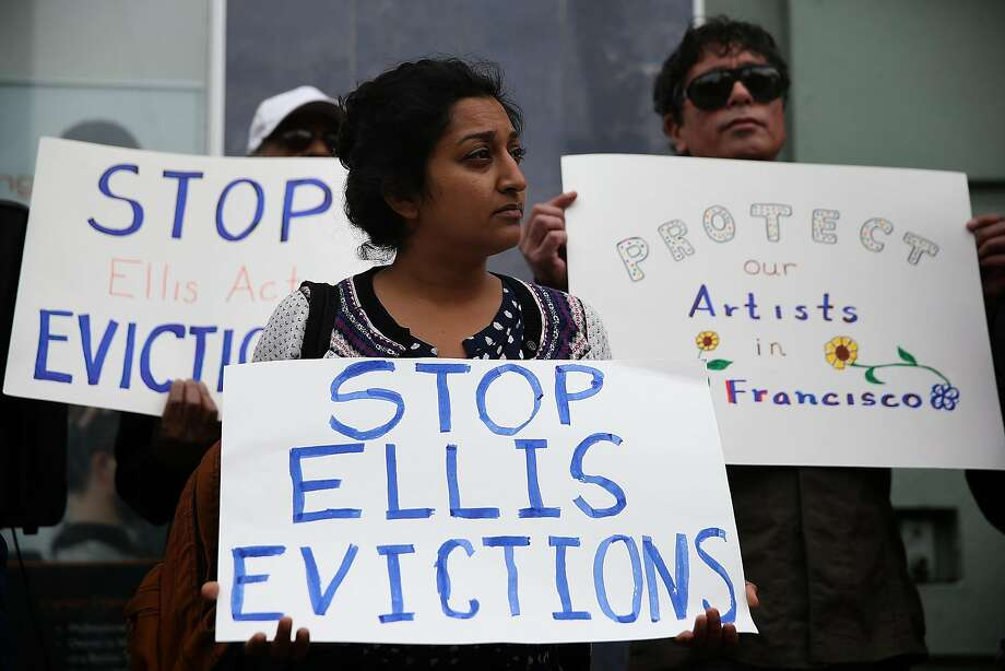 FILE:  Activists and tenants of 1049 Market Street hold signs as they stage a protest against the landlord's attempts to evict them from the building on March 8, 2016 in San Francisco, California.  (Photo by Justin Sullivan/Getty Images) Photo: Justin Sullivan, Getty Images