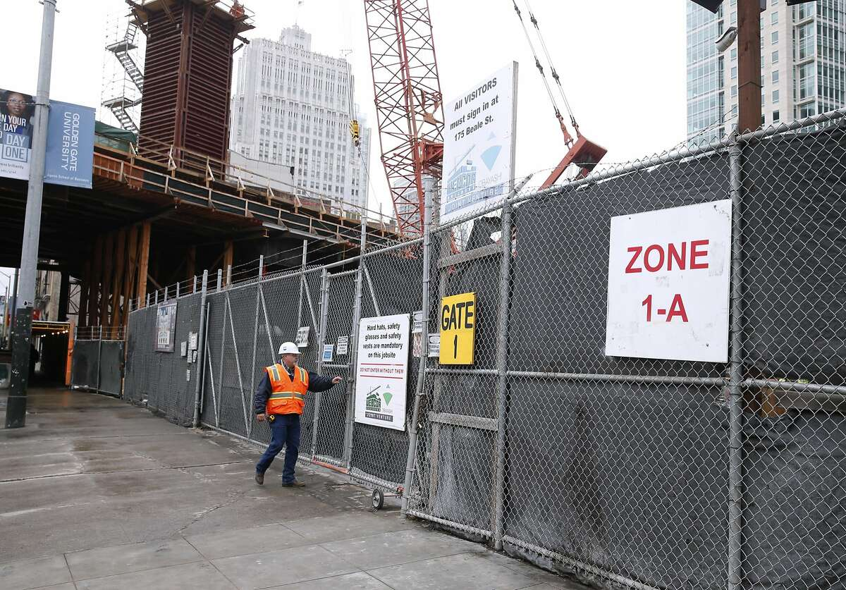 Construction equipment used for building the Transbay Transit Center occupies an empty lot on Howard Street between First and Second streets in San Francisco, Calif. on Thursday, March 10, 2016. The Transbay Joint Powers Authority has announced a deal has been reached to sell the parcel to a developer which will help offset a large gap in funding the transit project.