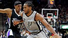 San Antonio Spurs' Kawhi Leonard drives around Sacramento Kings' Rajon Rondo during second half action Saturday March 5, 2016 at the AT&T Center. The Spurs won 104-94.