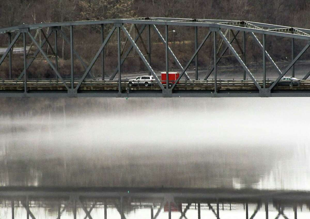 A low fog hangs between the Mohawk River and the Rexford Bridge Thursday, March 10, 2016, in Rexford, N.Y. (John Carl D'Annibale / Times Union)