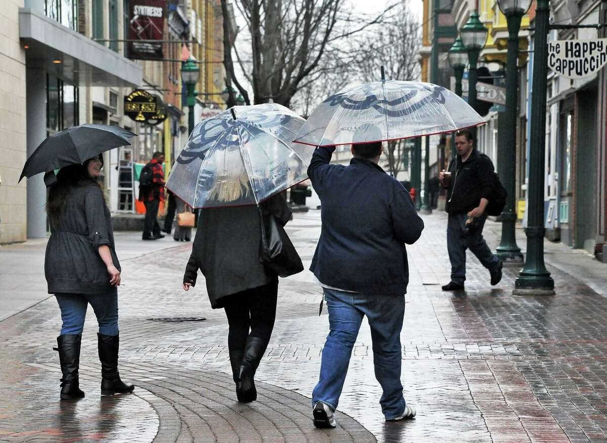 Umbrella covered pedestrians on Jay Street as rain begins to fall on Thursday, March 10, 2016, in Schenectady, N.Y. (John Carl D'Annibale / Times Union)
