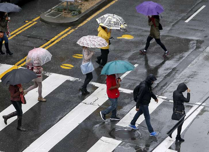 People are prepared for the rain as they cross Mission and Fourth streets in San Francisco, Calif. on Thursday, March 10, 2016 as the latest in a series of powerful storms rolls through the Bay Area.