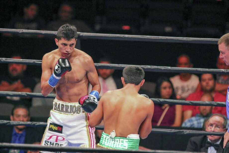Mario Barrios, in white shorts, goes Sunday Sept. 6, 2015 against Jose Cen Torres, in green shorts, at the American Bank Center in Corpus Christi. Barrios won with a knock-out in the fourth round. Photo: Micah DeBenedetto, For The Express-News / San Antonio Express-News / ©2015 San Antonio Express-News
