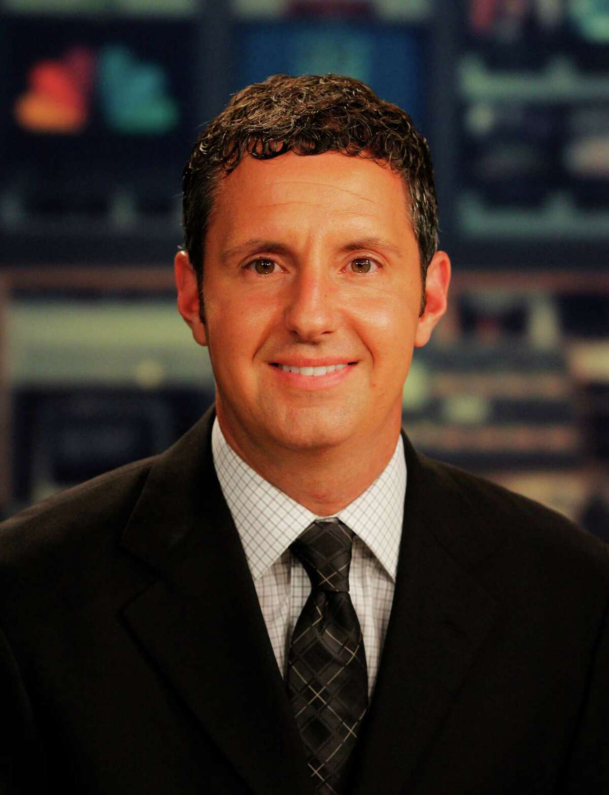 Andrew Catalon, a WNYT sports anchor pictured here in their studio in Menands, N.Y., Wednesday July 11, will be covering the Olympics for NBC this Summer. (Dan Little/Special to the Times Union)