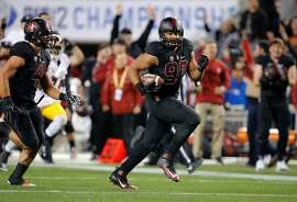 Stanford's Solomon Thomas, 90 is headed to the end zone on a third quarter fumble recovery, as Stanford went on to beat on the USC Trojans 41-22 in the NCAA College PAC-12 Football Championship at Levi Stadium in Santa Clara, Calif., on Saturday December 5, 2015.