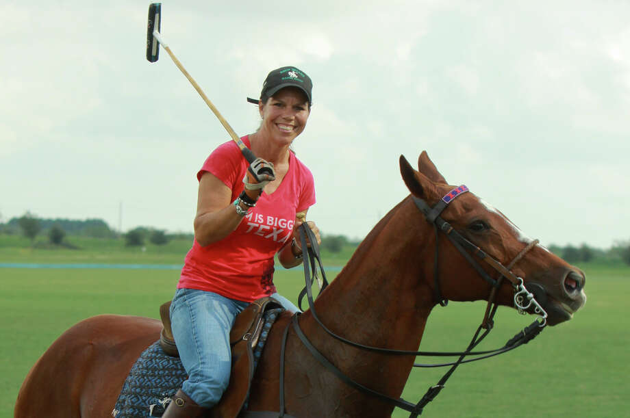 Kristy Waters Outhier, a professional polo player, exercises one of her horses, an American thoroughbred named Barbara, on Oct. 14, 2013, in Fulshear. Photo: Gary Fountain /For The Houston Chronicle / Copyright 2013 Gary Fountain.