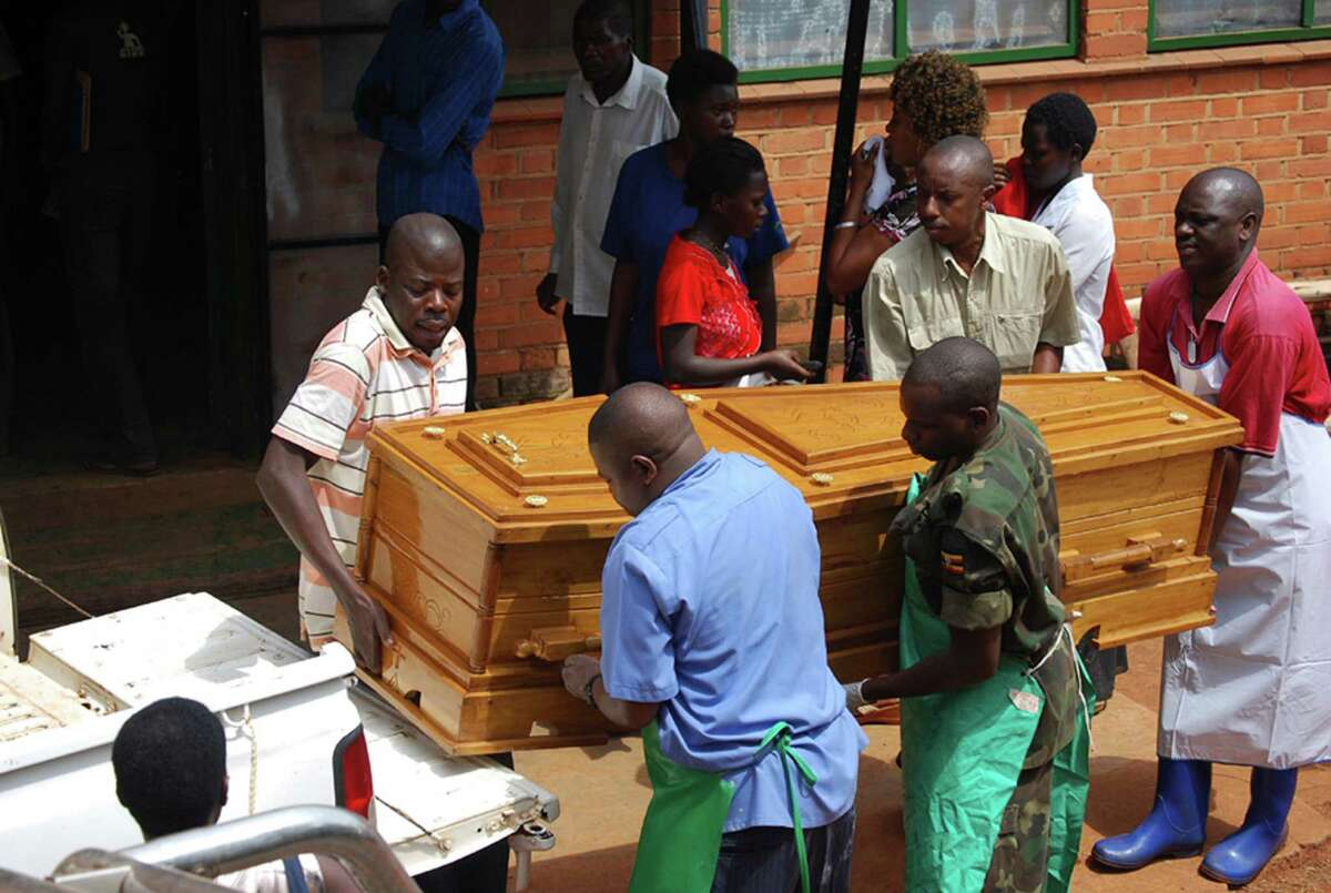 Relatives of one of the victims of a bombing and hospital staff carry away a body on July 13, 2010 in Uganda's capital city Kampala. The FBI says it found a phone number linked to a suspect in the bombing in the cell phone memory card of Abdullah Omar Fidse, who was sentenced in San Antonio on Thursday to prison for lying to agents conducting a terrorism investigation. (AP Photo / Stephen Wandera)