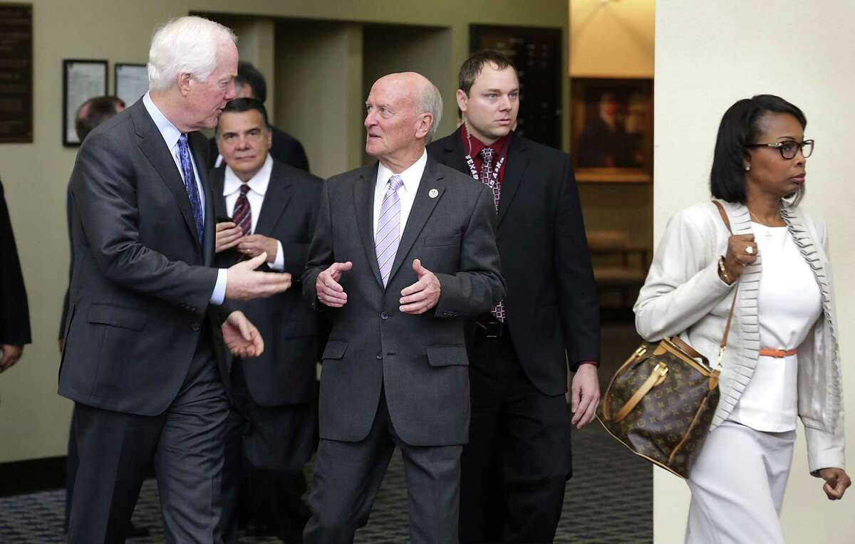 Sen. John Cornyn, left, talks with U.S. District Judge Fred Biery as U.S. District Judge Orlando Garcia (center, between Cornyn and Biery) looks on and Mayor Ivy Taylor walks to the next stop during a tour of the John H. Wood Federal Courthouse in November 2015. Biery will be hearing arguments Tuesday in a legal challenge to a Texas state initiative to purge tens of thousands from voter rolls who officials claim are not U.S. citizens but plaintiffs say unfairly and wrongly includes voters who are in fact citizens.
