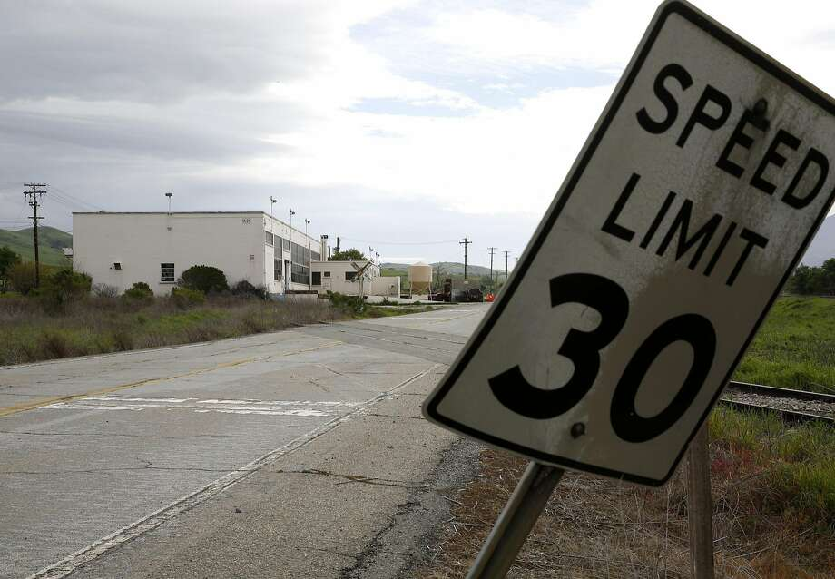 A bent over speed limit sign near an unused building in the Concord Naval Weapons Station in Concord. One of two developers bidding for the redevelopment project says it will withdraw unless new terms are met. Photo: Connor Radnovich Connor Radnovich, The Chronicle