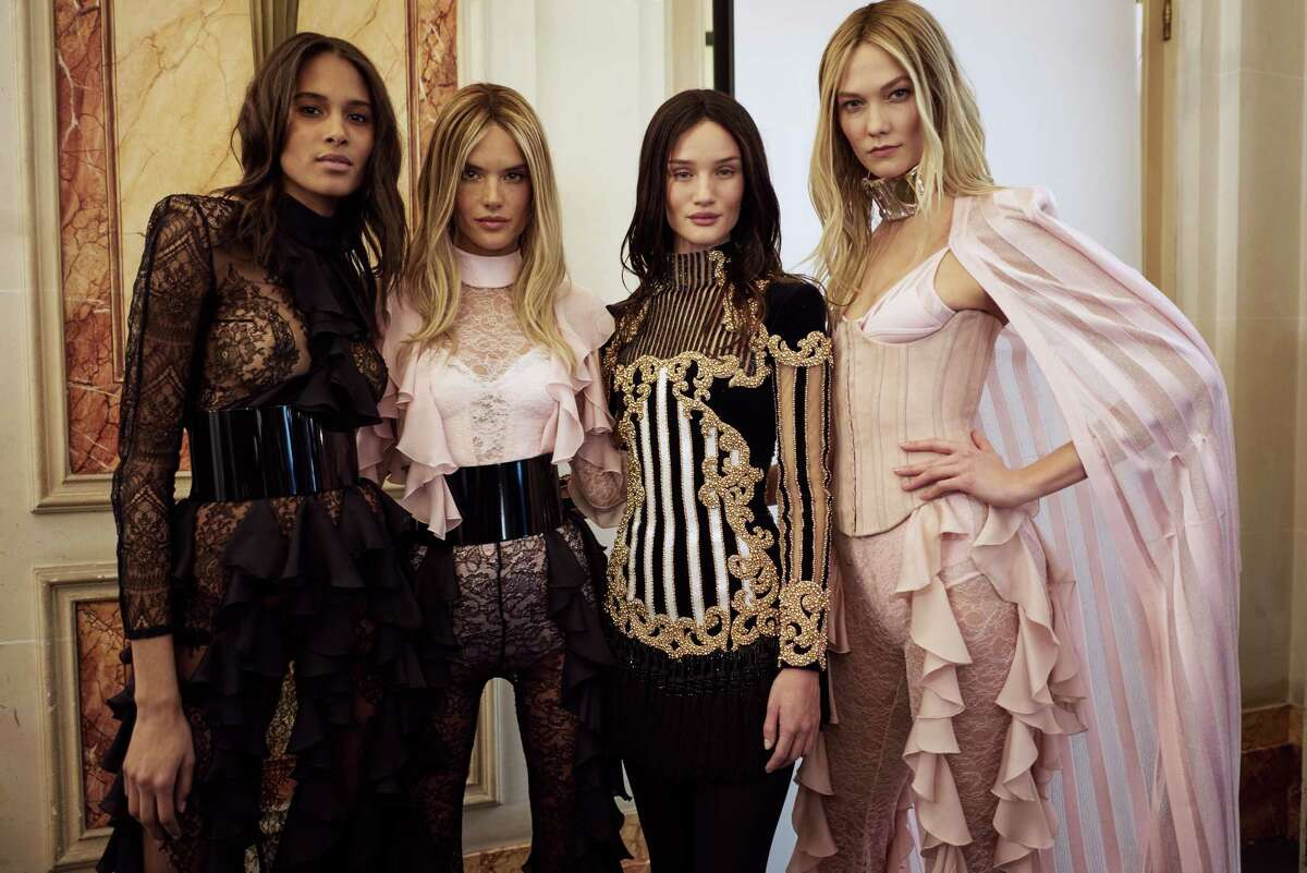 Cindy Bruna, Alessandra Ambrosia, Rosie Huntington-Whiteley and Karlie Kloss at Paris Fashion Week on March 3, 2016.