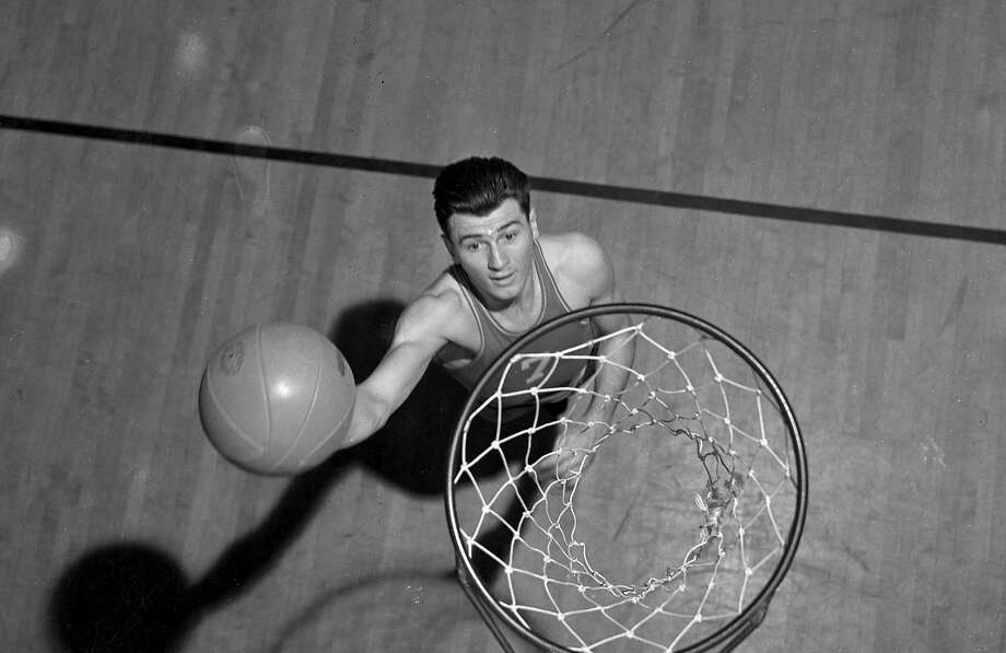 Hank Luisetti Luisetti developed the running one-handed shot Photo: Chronicle File, The Chronicle