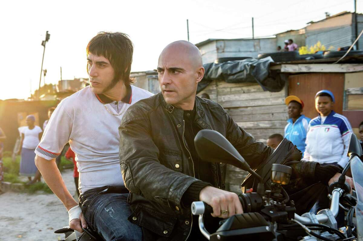 This image released by Sony Pictures shows Sacha Baron Cohen, left, and Mark Strong in Columbia Pictures'