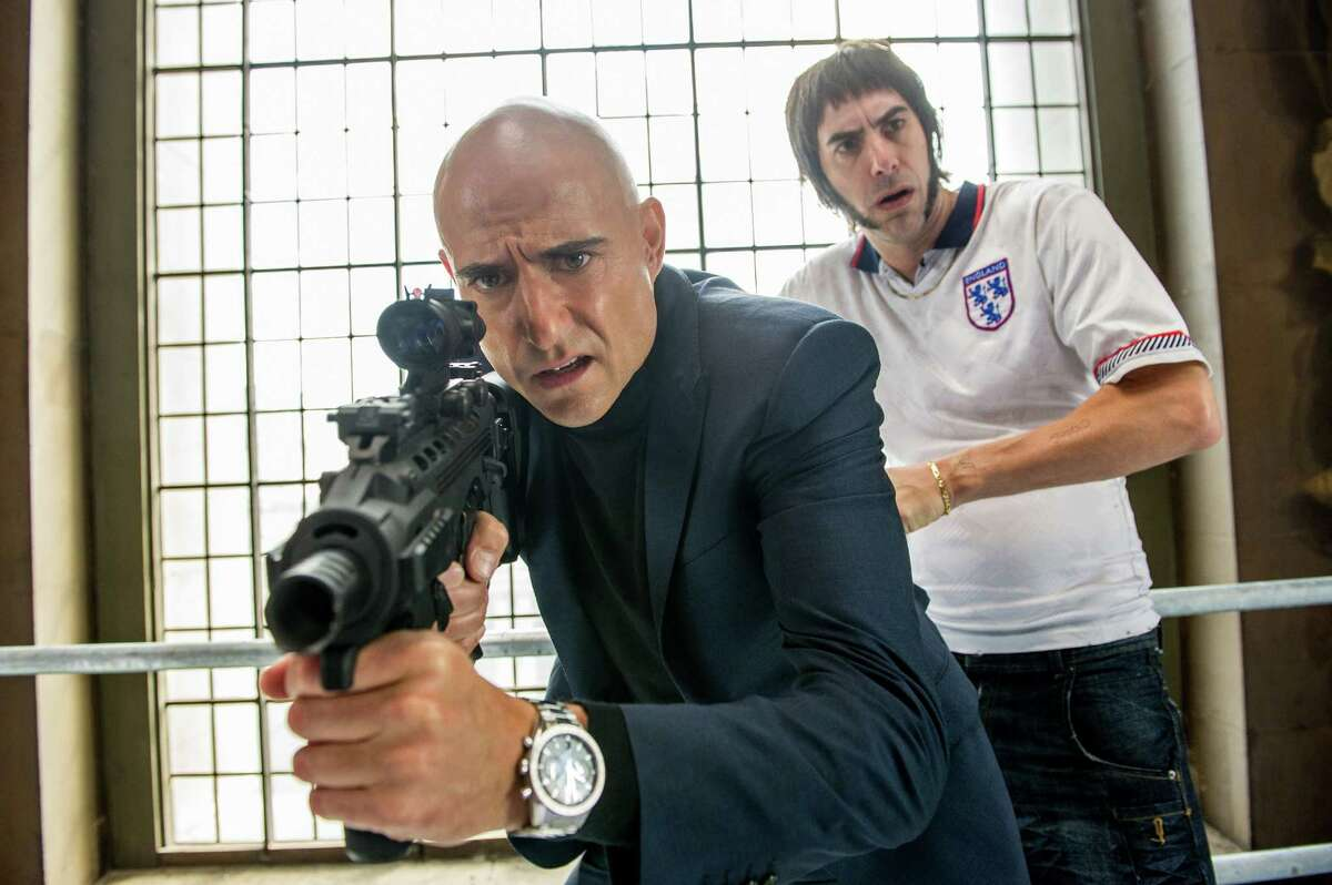 This image released by Sony Pictures shows Sacha Baron Cohen, right, and Mark Strong in Columbia Pictures'