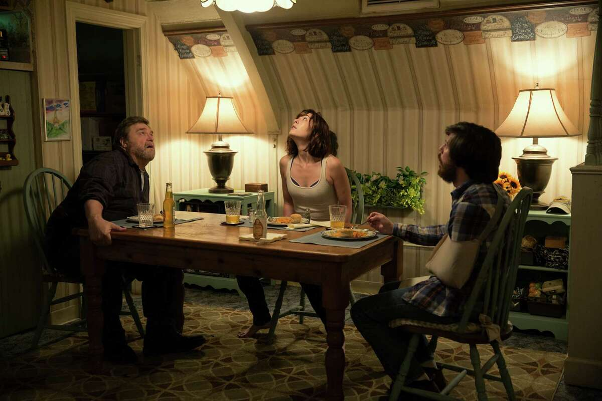 This image released by Paramount Pictures shows John Goodman, from left, Mary Elizabeth Winstead and John Gallagher Jr. in a scene from