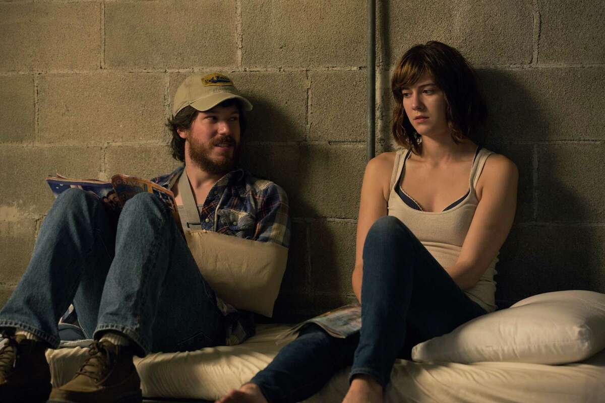 This image released by Paramount Pictures shows John Gallagher Jr., left, and Mary Elizabeth Winstead in a scene from