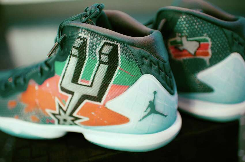 A pairing between Spurs Sports and Entertainment (SS&E) and an organization called the Eastside Promise Neighborhood resulted in the creation of another pair - eight pairs of Jordan Super.Fly 4s shoes.