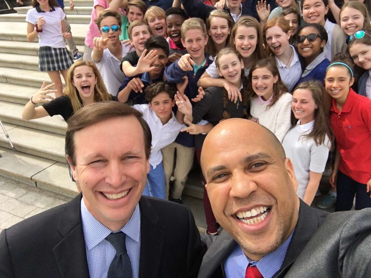 U.S. Sens. Chris Murphy, D-Conn., and Cory Booker, D-N.J., take a selfie with students from Greens Farms Academy in Westport outside the U.S. Capitol in Washington, D.C., Thursday, March 10, 2016.