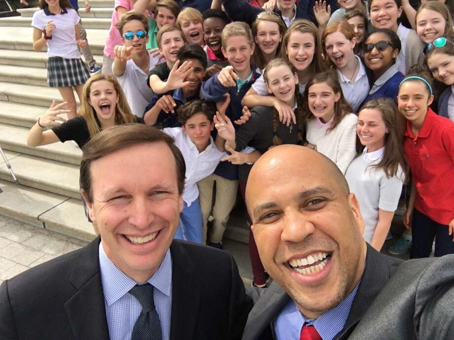 U.S. Sens. Chris Murphy, D-Conn., and Cory Booker, D-N.J., take a selfie with students from Greens Farms Academy in Westport outside the U.S. Capitol in Washington, D.C., Thursday, March 10, 2016. Photo: / Twitter