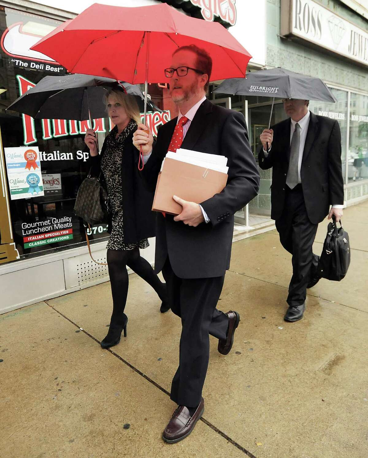 Lawyers for Cabot Oil & Gas based in Houston, Texas, leave the William J. Nealon Federal Building and U.S. Courhouse in downtown Scranton, Pa., on Thursday, March 10, 2016, after Cabot lost its case against two Dimock Township families. The Ely family were awarded $ 2.75 million dollars and the Hubert family were awarded $ 1.49 million dollars by a grand jury. Cabot was ruled responsible for contaminating the familes well water with high levels of methane. Both families have been pursuing the case for 6 years after rejecting a settlement offer in 2012. ( Butch Comegys / The Times & Tribune via AP) MANDATORY CREDIT ORG XMIT: PASCR105