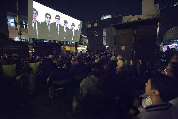 "A couple hundred people gather for the Proxy Fall Film Festival near Octavia and Hayes streets, Friday, Nov. 13, 2015, in San Francisco, Calif. The free walk-in movie theatre featured ""The Wolfpack."""