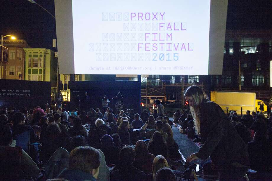 "A couple hundred people gather for the Proxy Fall Film Festival near Octavia and Hayes streets, Friday, Nov. 13, 2015, in San Francisco, Calif. The free walk-in movie theatre featured ""The Wolfpack."" Photo: Santiago Mejia, Special To The Chronicle"