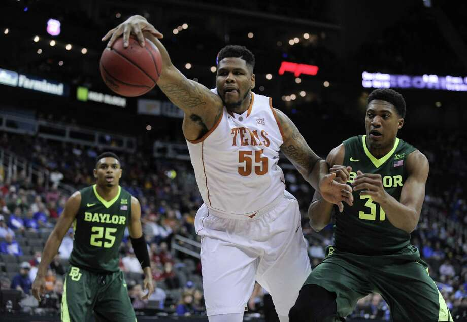 KANSAS CITY, MO - MARCH 10:  Cameron Ridley #55 of the Texas Longhorns reaches out as he tries to gain control of the ball against Terry Maston #31 of the Baylor Bears in the first half during the quarterfinals of the Big 12 Basketball Tournament at Sprint Center on March 10, 2016 in Kansas City, Missouri. (Photo by Ed Zurga/Getty Images) Photo: Ed Zurga, Stringer / Getty Images / 2016 Getty Images