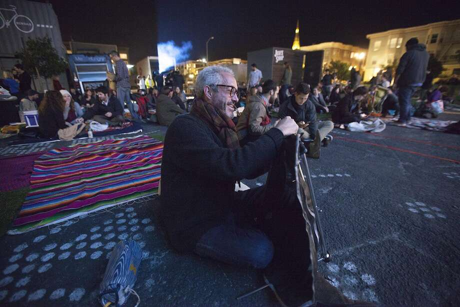 Don Lusty, who lives in the neighborhood, finds a spot and sets up his chair. Photo: Santiago Mejia, Special To The Chronicle