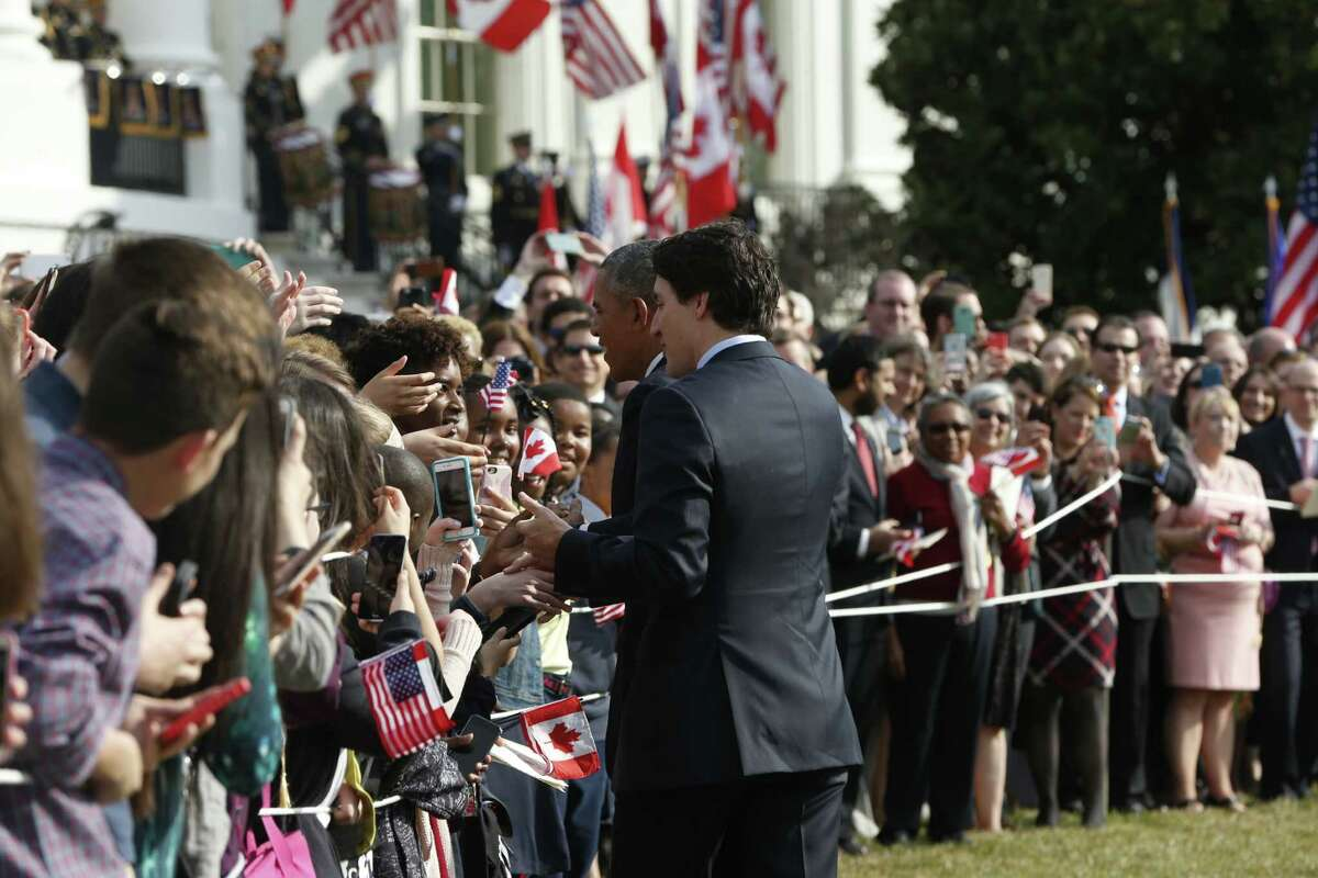 President Barack Obama and Canadian Prime Minister Justin Trudeau, greet guests on the South Lawn of the White House on Trudeau's arrival, Thursday, March 10, 2016 in Washington, (AP Photo/Pablo Martinez Monsivais)