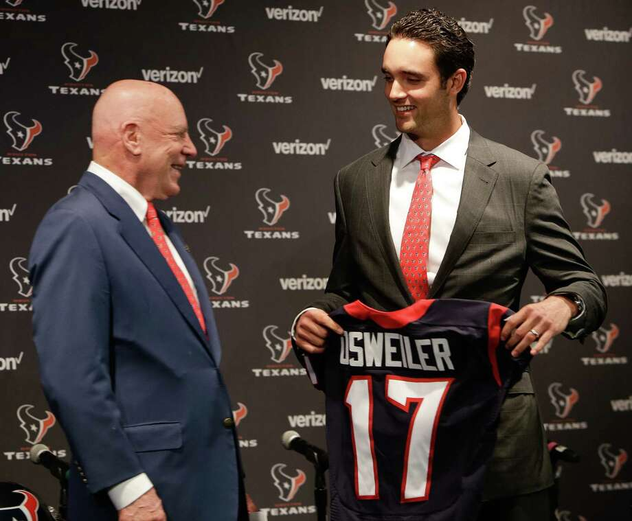 New Texans quarterback Brock Osweiler shares a laugh with team owner Bob McNair at Thursday's introductory news conference at NRG Stadium. (Brett Coomer, Houston Chronicle) Photo: Brett Coomer / Houston Chronicle