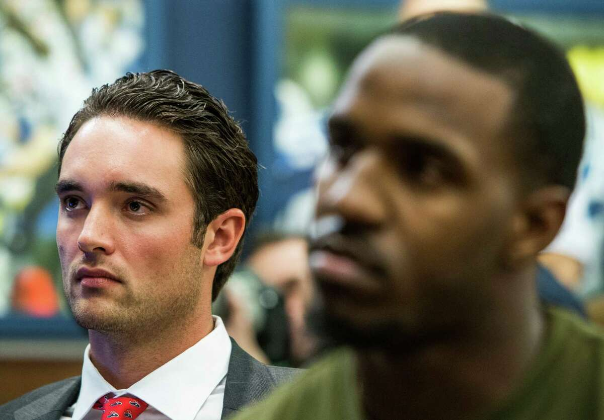 Houston Texans quarterback Brock Osweiler, left, sits with running back Lamar Miller during a news conference announcing their signing with the team at NRG Stadium on Thursday, March 10, 2016, in Houston. The Texans introduced four free agent signees Thursday, including Osweiler, Miller, center, Tony Bergstrom and guard Jeff Allen.